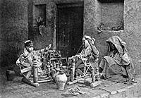 Spinning wool into yarn, c. 1900 (J.K. Mumford).